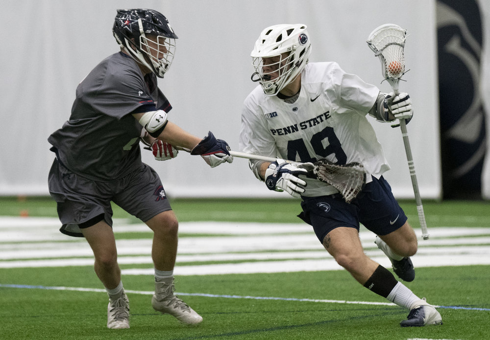 Attacker Nate Buller (49) cradles the ball during the men's lacrosse game against Robert Morris at Holuba Hall on Feb. 9, 2019. The Nittany Lions score a program record 27 points to rout Robert Morris 27-10. | Photo by: Noah Riffe
