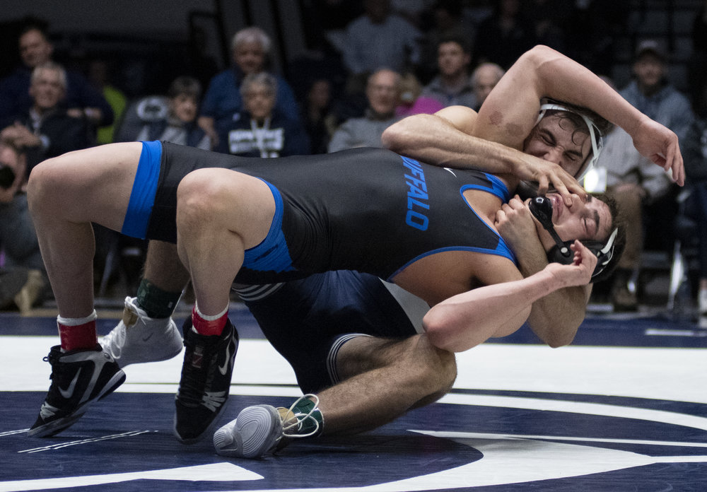 Anthony Cassar flips Sam Schuyler during the wrestling match against Buffalo at Rec Hall, Sunday, Feb. 24, 2019. On Senior Day, Penn State defeat Buffalo 47-3. | Photo by: Noah Riffe