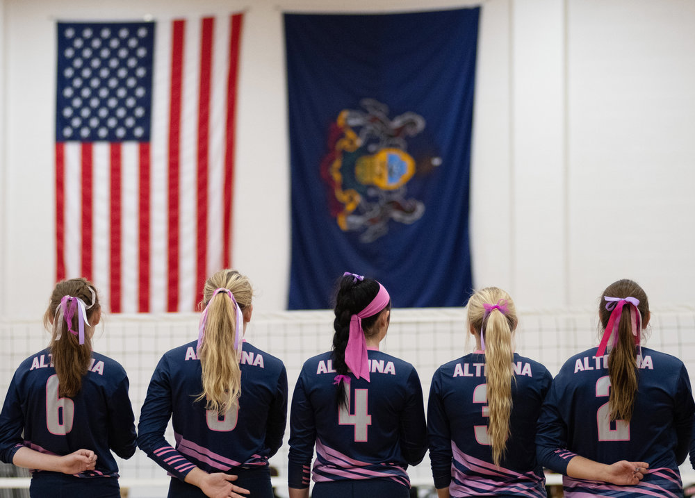 Penn State Altoona Women's Volleyball players Kaitlin Cassaday (#6), Emily Bryan (#5), Paige Burk (#4), Lea Crofcheck (#3), and Velanna Skripek (#2) stand for the National Anthem before their game against La Roche College on Wednesday, Oct. 10, 2018 at Adler Arena in Altoona.