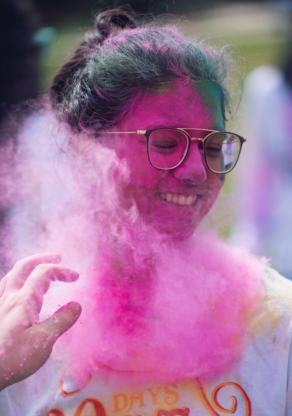 Krittika Shahani (freshman-computer science) gets powder thrown at her during the Hindu festival, Holi, hosted by the Indian Culture and Language Club and South Asian Student Association on Sunday, April 7, 2019 at the HUB-Robeson Center lawn. | Photo by: Noah Riffe