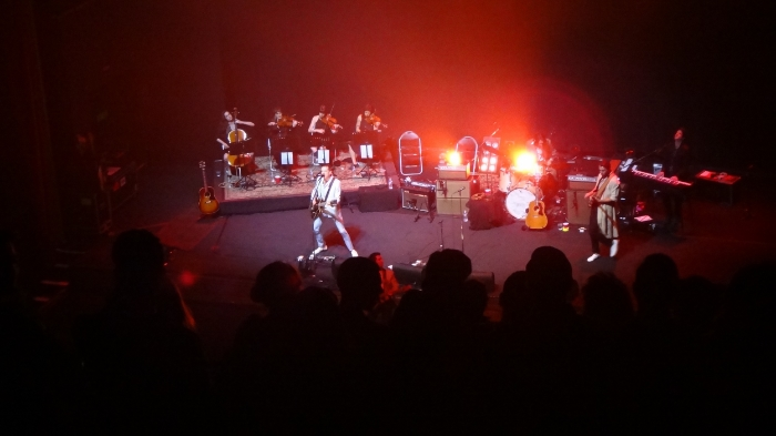 The Last Shadow Puppets - Miles Kane holds down the stage while Alex Turner (bathed in red light) commands the front row.