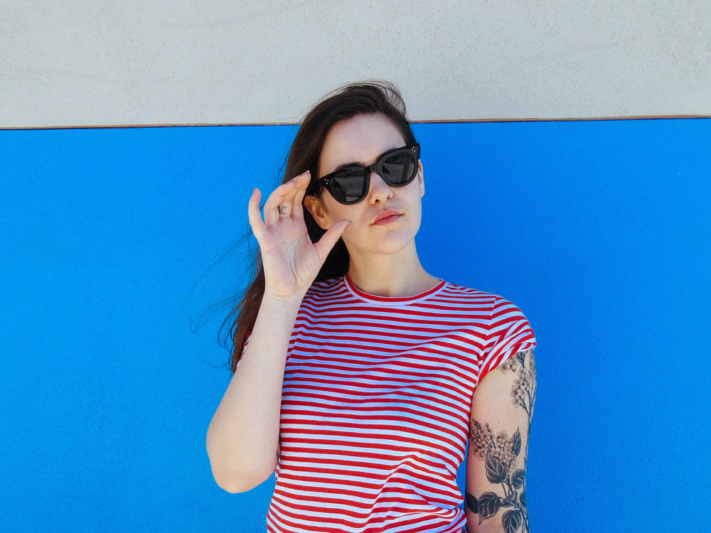 Everlane medium striped crew and Céline sunglasses.