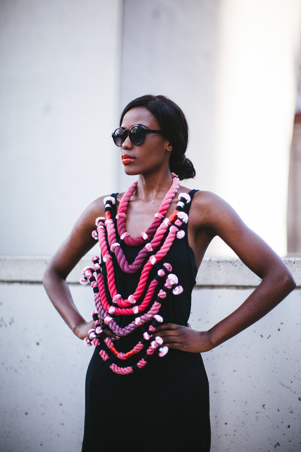 "Photographer: Cecilia Corsano  Model: Anita Mwiruki  Wearing the ""Blood Champagne"" necklace"