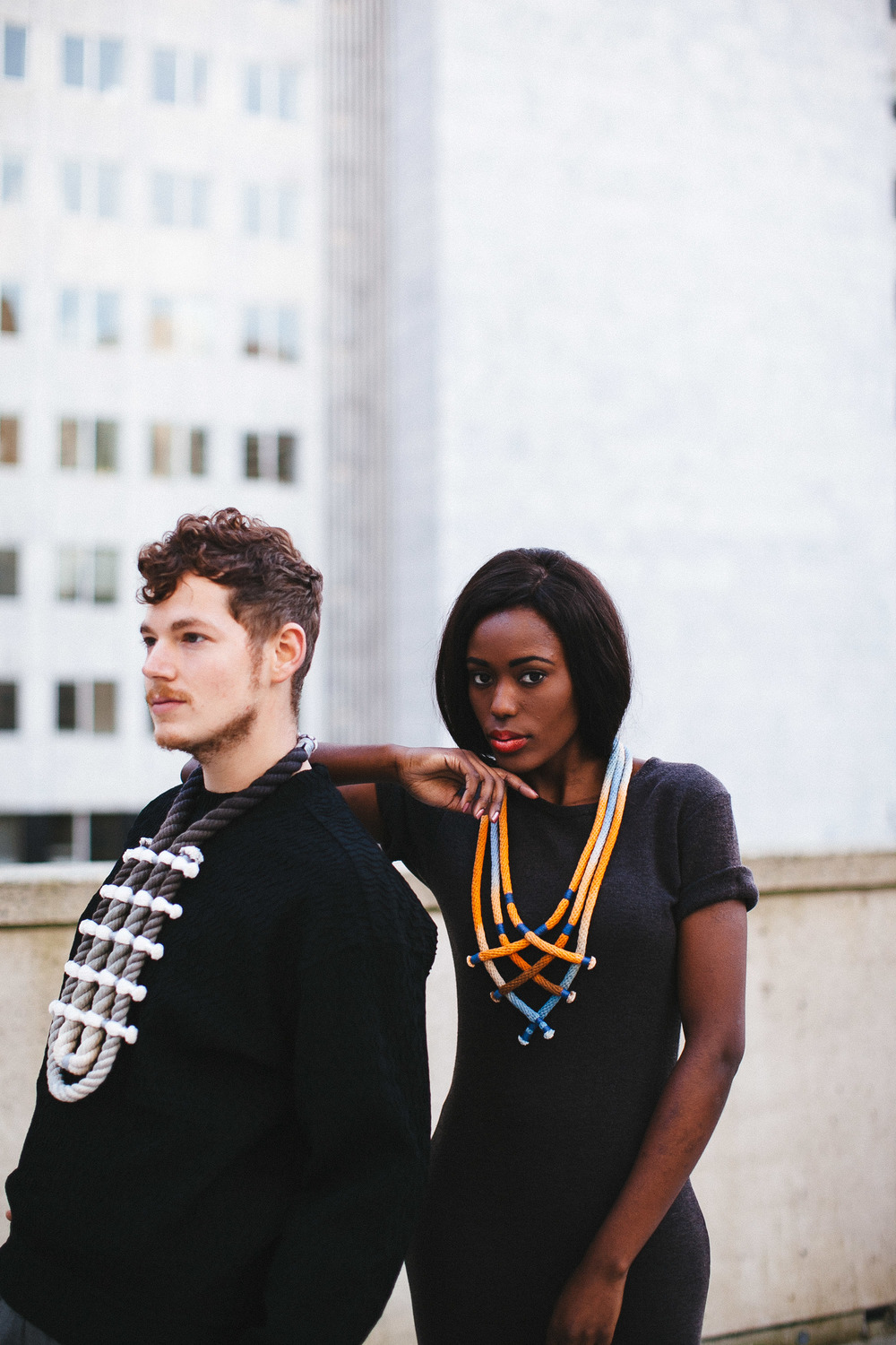 "Photographer: Cecilia Corsano  Model: Anita Mwiruki  L to R: Wearing the ""Border"" and ""Some Some #2"" necklace"