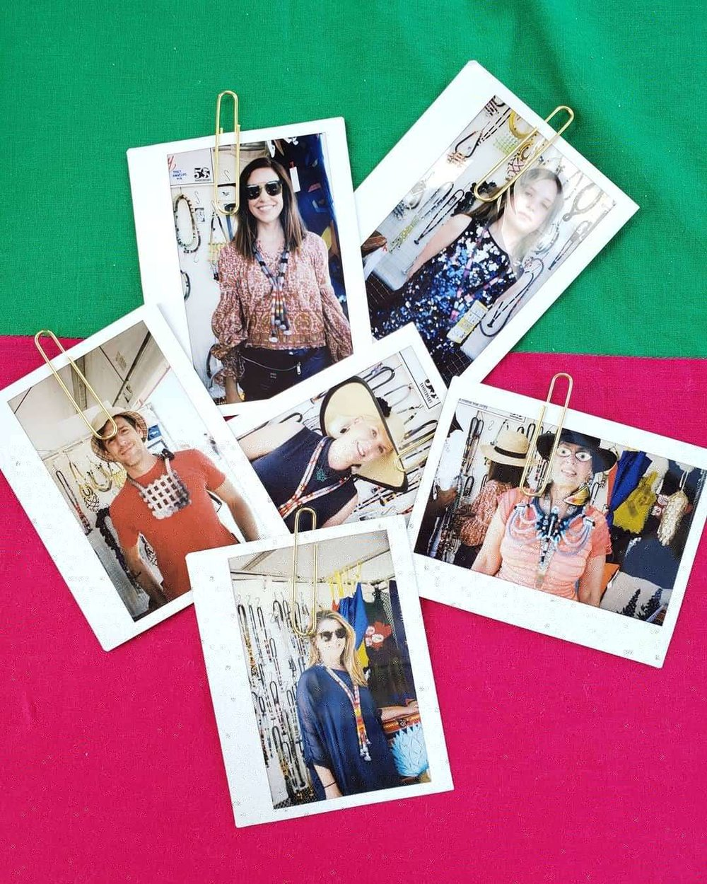Poloroids of customers in their new Neon Zinn.