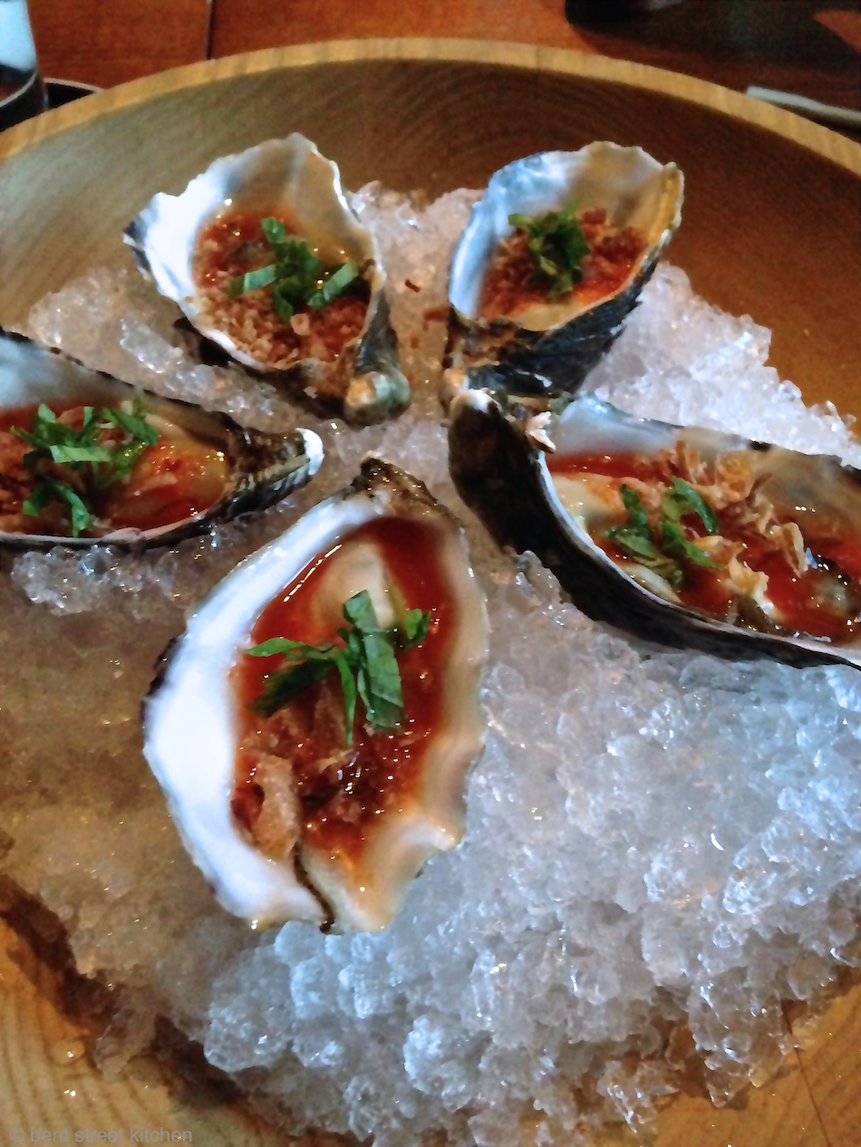 shucked oyster with lime, chilli nam jim & crispy shallots