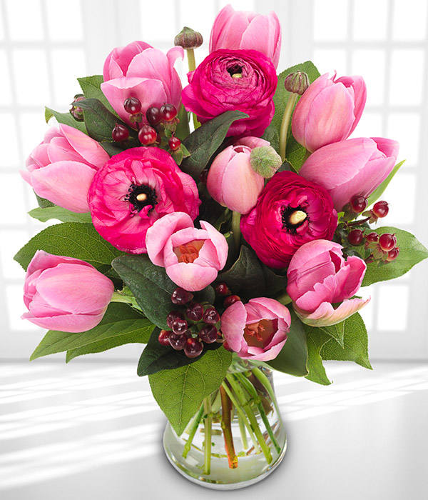 Think Pink - This hand tied mix of the finest pink tulips and hypericum.  Shop the basket here