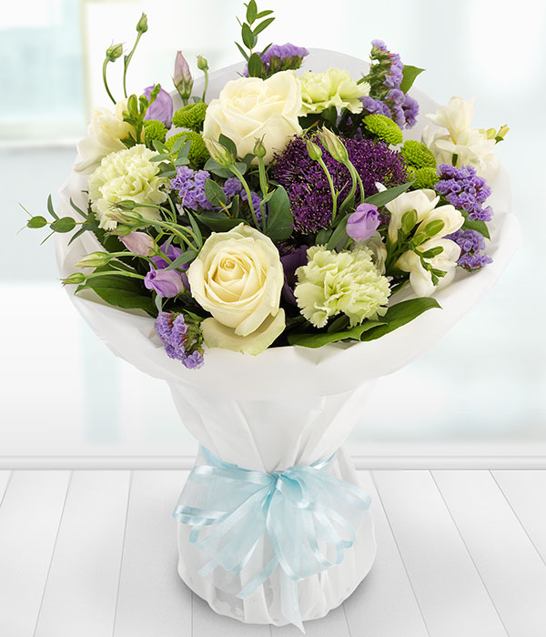 Simply Vintage - A delicate and fragrant mix of white Roses and Freesias with lilac Lisianthus and Trachelium, coupled with lavender Statis, green Spray Chrysanthemums and Carnations.Shop the bouquet here