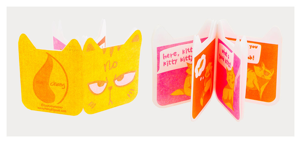 """""""no"""" a 4x6"""" six-page zine detailing a grumpy cat and its begrudging relationship with its human. duotone risograph and hand cut into the shape of a cat's head"""