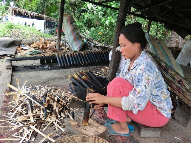 Woman making bamboo sticky rice