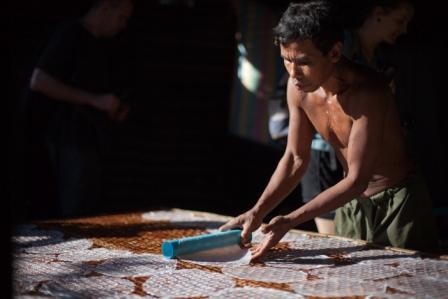 Man drying rice paper