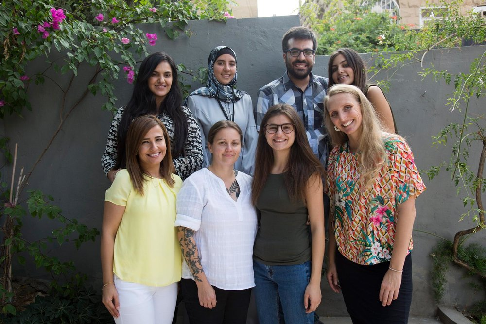 Back row (l to r): Walaa (representative from AWO), Doaa (data researcher from Jordan), Abdou (data researcher from Tunisia), Farah (graphic designer from Egypt)  Front row (l to r): Manal (representative from AWO), Jill (front end developer from the US), Tala (journalist from Jordan), Skye (team leader, DATA4CHANGE alumni)