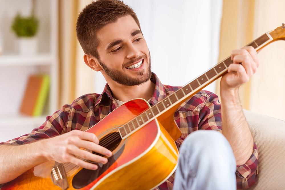 happy guitar player