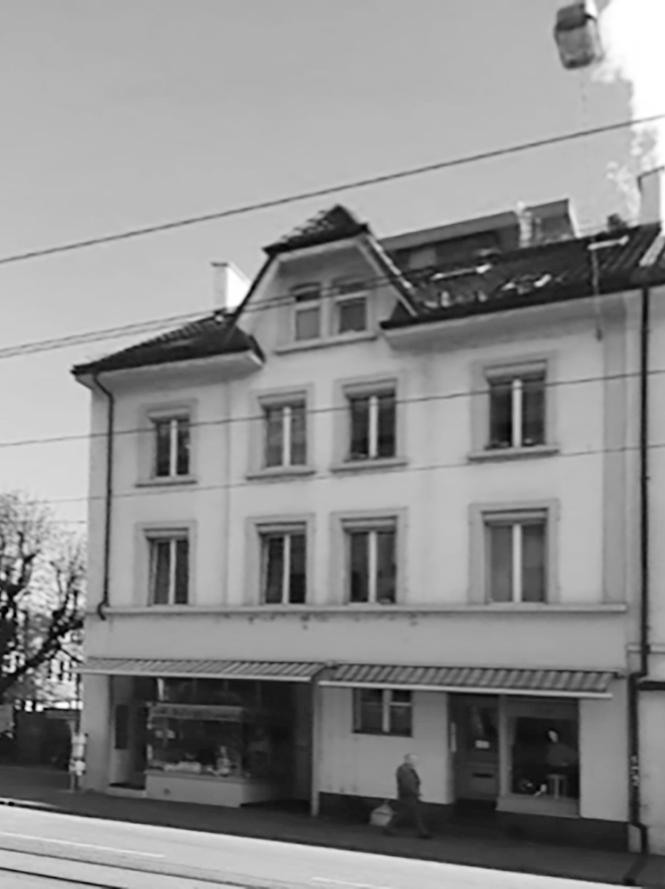… in Basel ein Mehrfamilienhaus mit 8 Wohnungen, zwei Ateliers und zwei Läden
