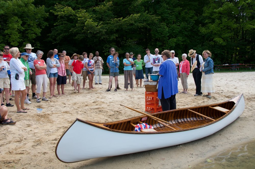 - Lester's Boat Christening CeremonyLester and friends refurbished this Thompson canoe, achieveing a life goal. Here family and friends gathered to christen his boat at Bluebird Pond in Copley with Kathleen officiating.