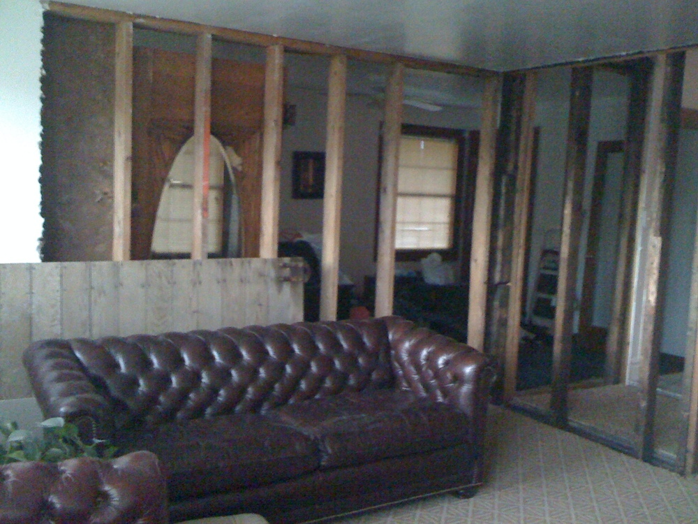 b4: dining room looking left to the living room and right to the entryway.