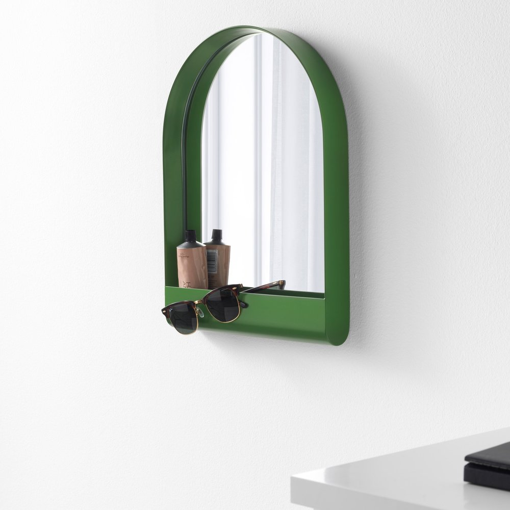 Take a look at this mirror. And it's green (we know...again with the green obsession). There are actually a few more sizes/colors from this new line. Hang several on your wall to add great textural and colorful elements to a room, or go simple and use one mirror as the main pop of color in a small bath or bedroom.