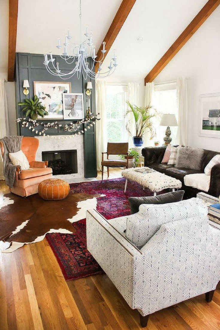 Cowhide Rug Mixed With Traditional Pattern Carpet U2013 Layering Rugs Trend  Inspiration. Check Our Ideas