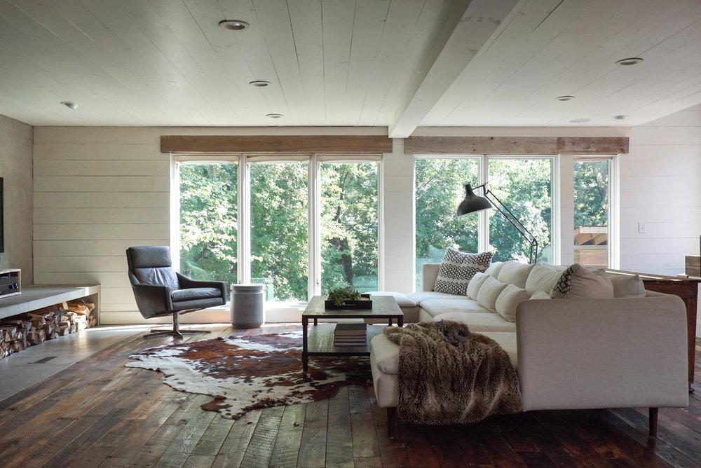 modern scandinavian living room wall of windows.jpg