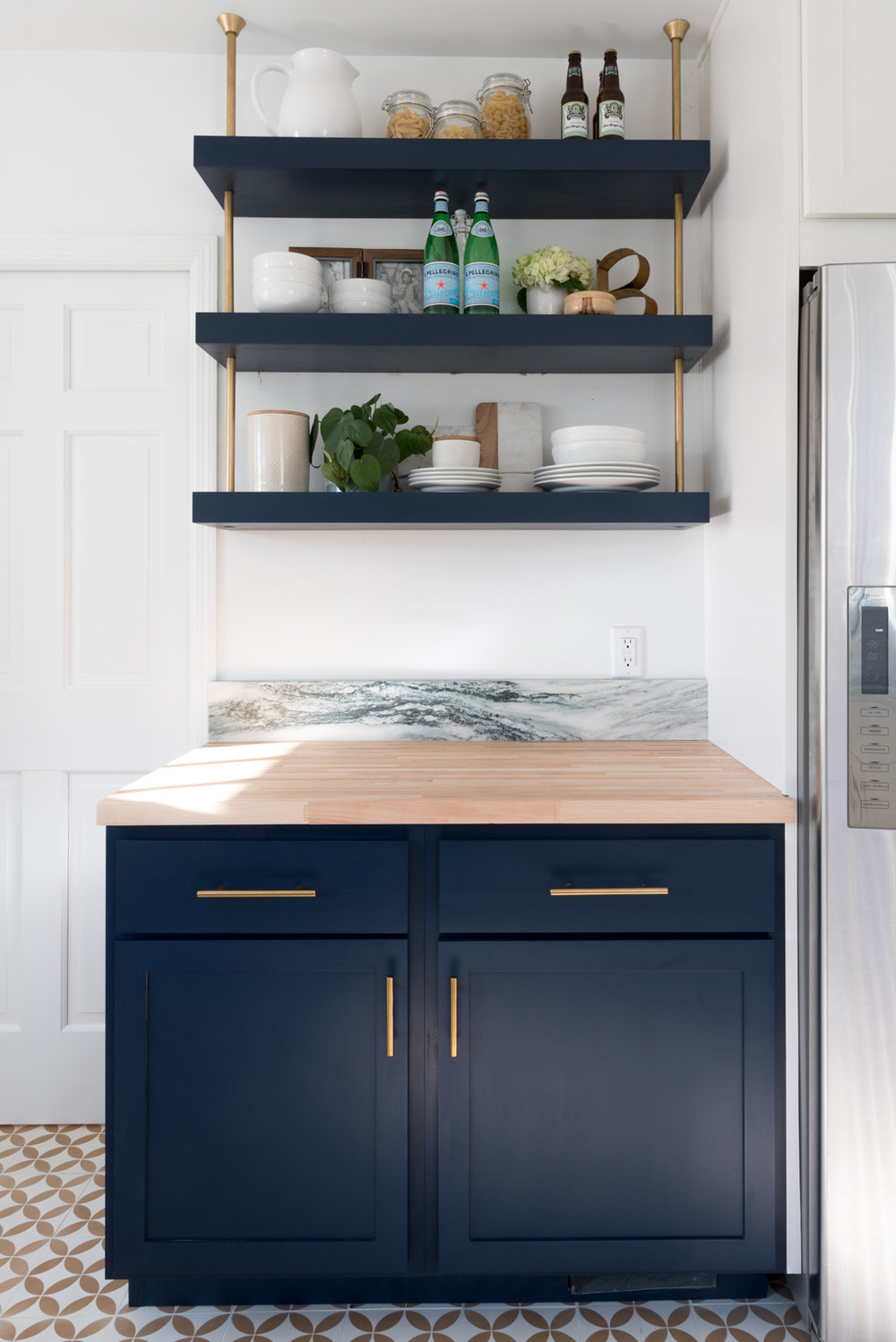 navy and marble kitchen