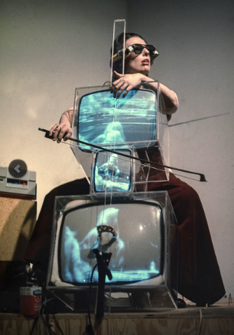 Charlotte Moorman performs Nam June Paik's 'TV Cello', wearing TV Glasses, New York, 1971
