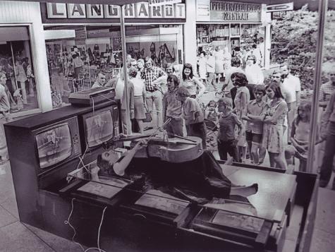 Charlotte Moorman performs Nam June Paik's 'TV Bed, Bochum Art Week', Bochum, West Germany, 1973