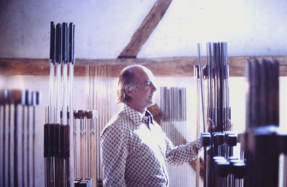 Bertoia playing sounding pieces in his barn, 1973, Photo by and courtesy of Beverly H. Twitchell