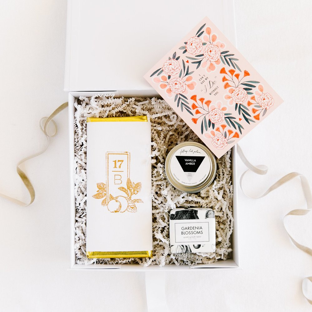 "Can't say ""I DO"" without your crew! Ask your ride or die girls to stand by your side with a   ""BRIDE'S TRIBE""   box. This petite keepsake box includes a card, chocolate, a fun bath fizzy + candle!"