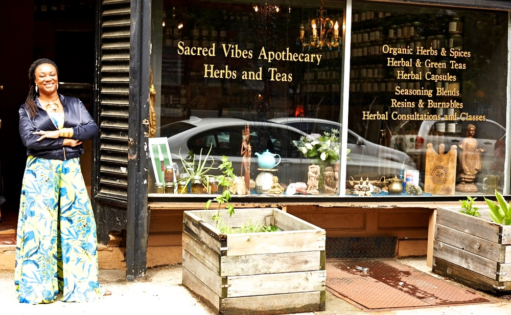 Karen Rose in front of our Brooklyn Apothecary