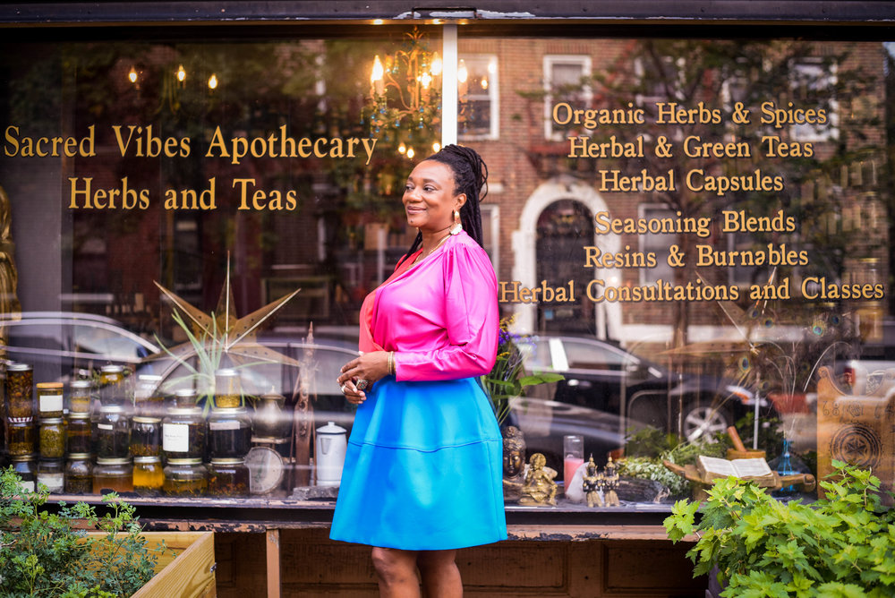 Herbalist and Spiritual Teacher Karen Rose inside Sacred Vibes Apothecary