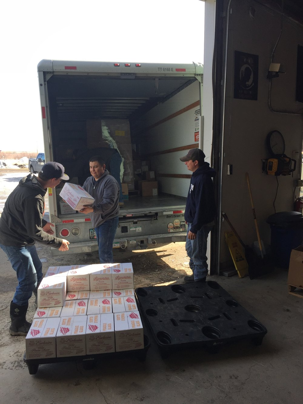 Unloading some boxes of Stanislaus sauce