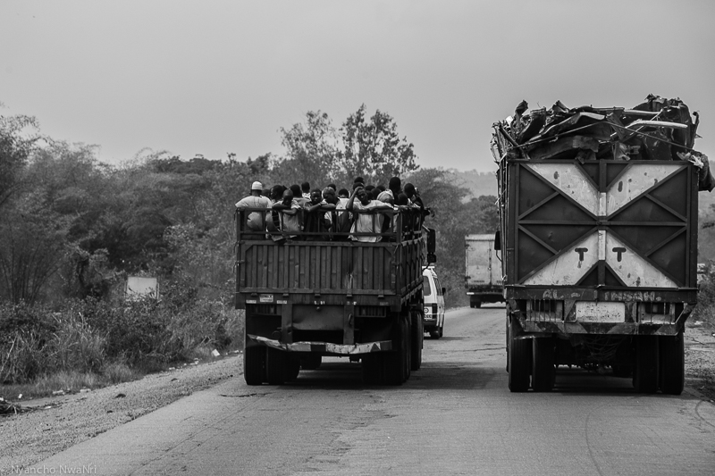 Workers and materials are transported via lorry on Lagos-Ibadan Expressway. Ogun, Nigeria. 2015