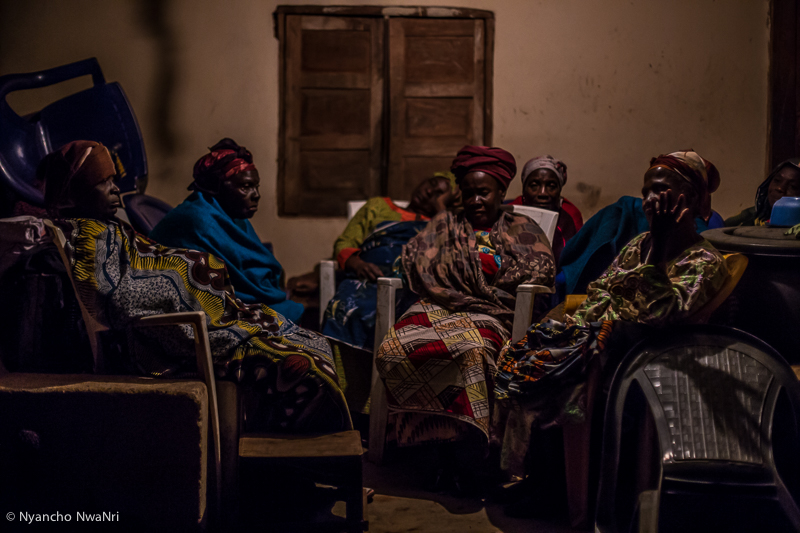 Elderly women mourn at the wake-keeping of a relative. Benue, Nigeria. 2017