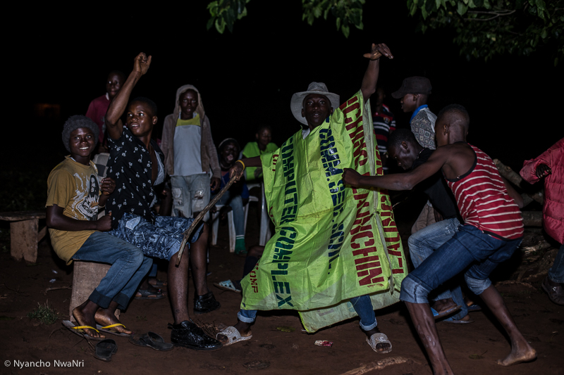 A group of youths dance at the wake-keeping of a villager. Benue, Nigeria. 2017