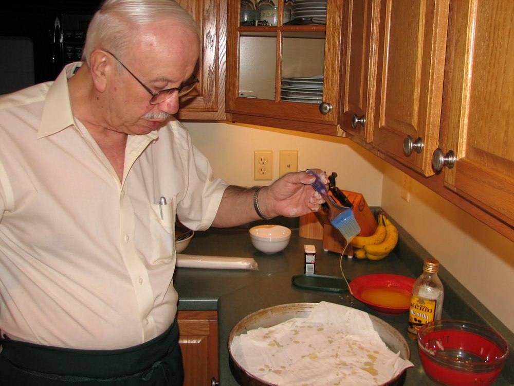 Bill didn't get fussy about brushing butter over the phyllo dough. He just drizzled butter on, then added another layer of phyllo sheets.