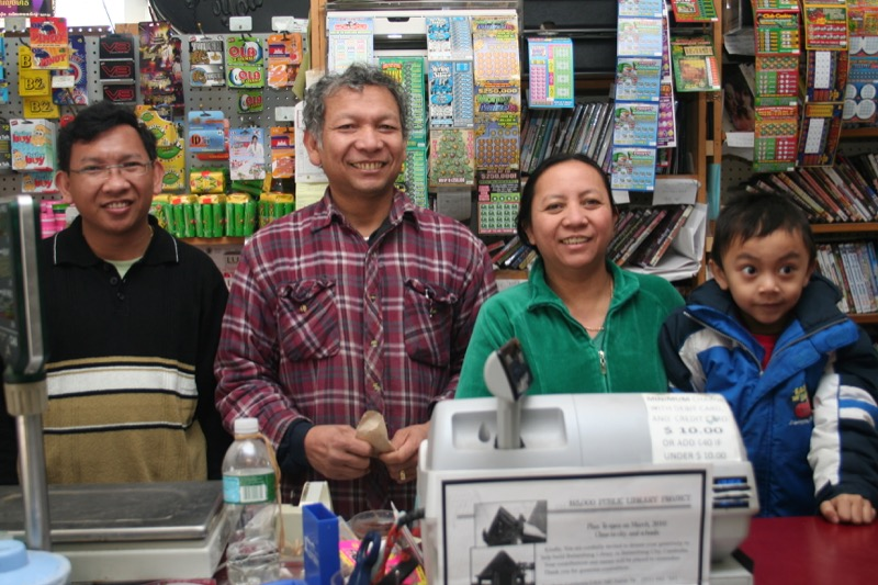 Co-owners Bunrith Pok and Mealy Khiev (pictured center) of Haknuman Meanchey Asian Market.