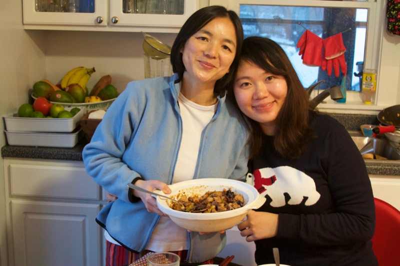 Lily Ou (left) from Guilin, China, and her friend, Peng Qiao, from Chong Qiang, China, share their Kung Pao Chicken method -- and Lily's great love story -- with us.