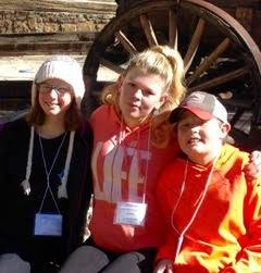 Tired, but happy! Some St. John's Youth members after a fun weekend at Quest, the diocesan youth retreat at Frontier Ranch in Buena Vista!