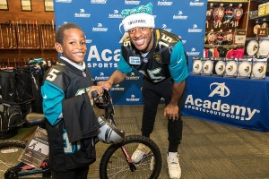 Jacksonville wide receiver Allen Robinson donates bicycles and autographed footballs for Boys & Girls Club members.