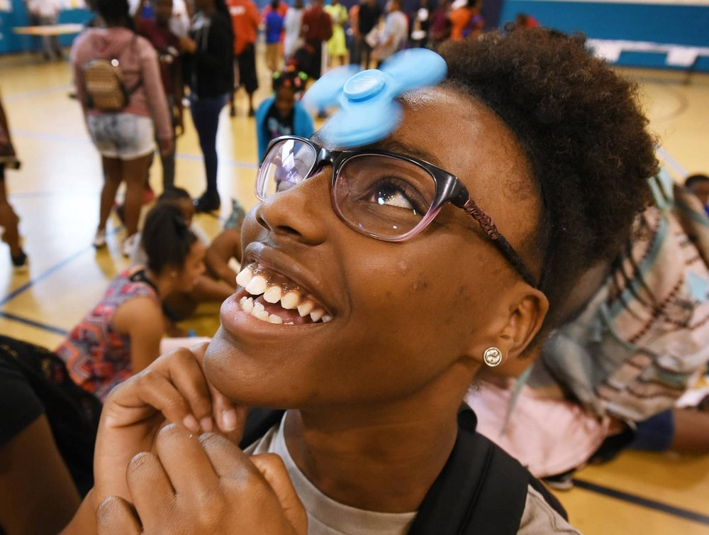 NFL YET Boys & Girls Club member Maya Stephens, 14, balances her fidget spinner effortlessly on her forehead.