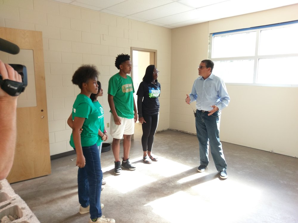 Boys & Girls Clubs of Northeast Florida President and CEO, Paul Martinez, gives Boys & Girls Club members a tour of the Citi Teen Center currently under construction.