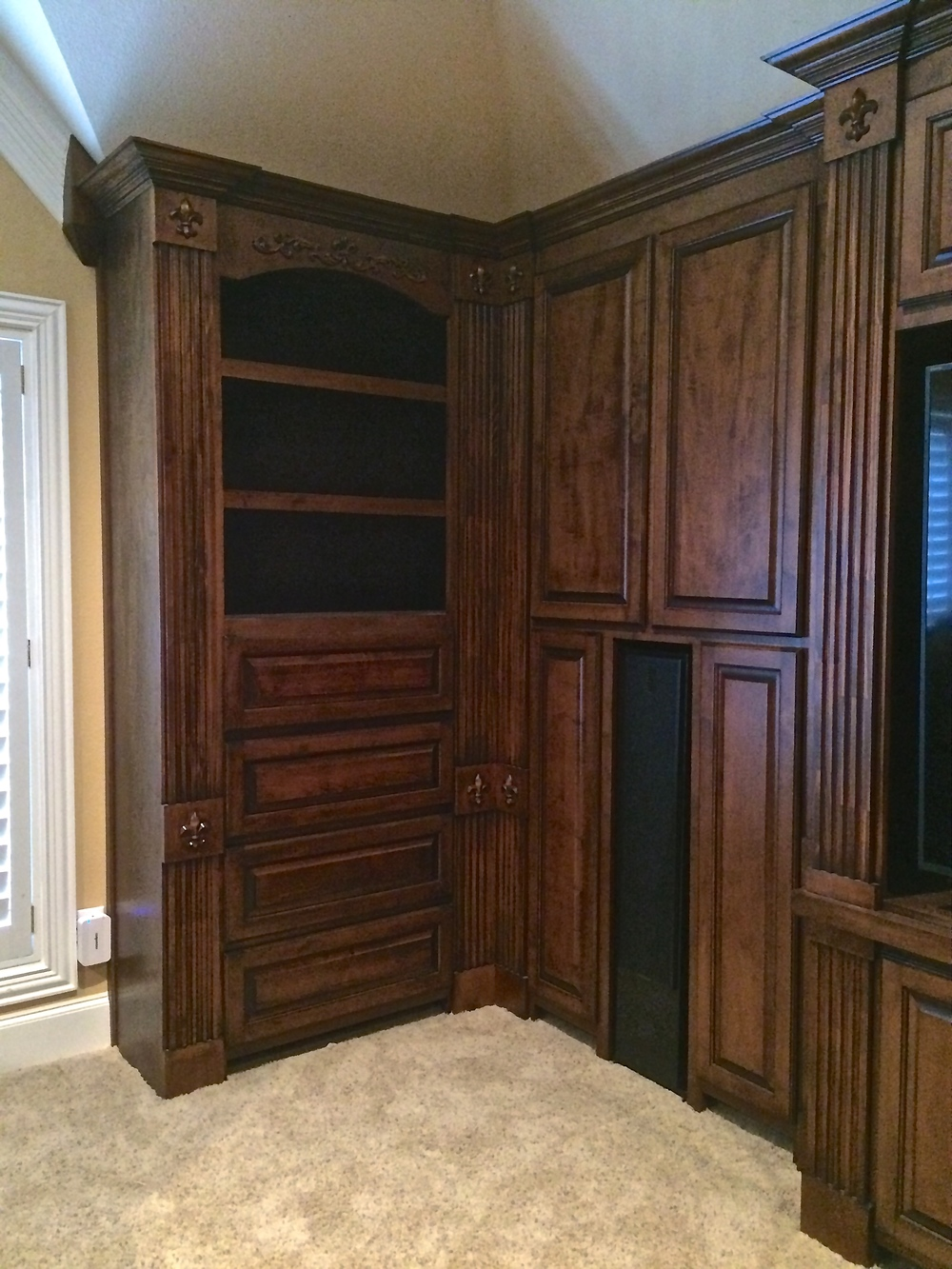 Traditional Bookcase with Fluted Pilasters, Applied Carvings, Drawers, and Adjustable Shelves