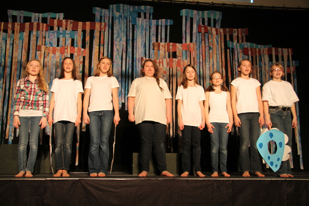 chorus singing traditional songs about flooding.JPG