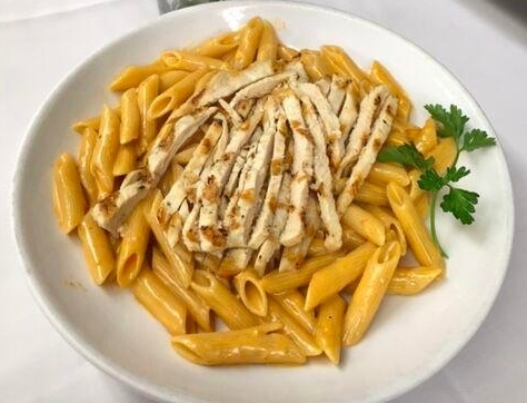 Calling all pasta lovers! Try our Penne Ala Vodka, topped off with your choice of grilled Chicken or shrimp!