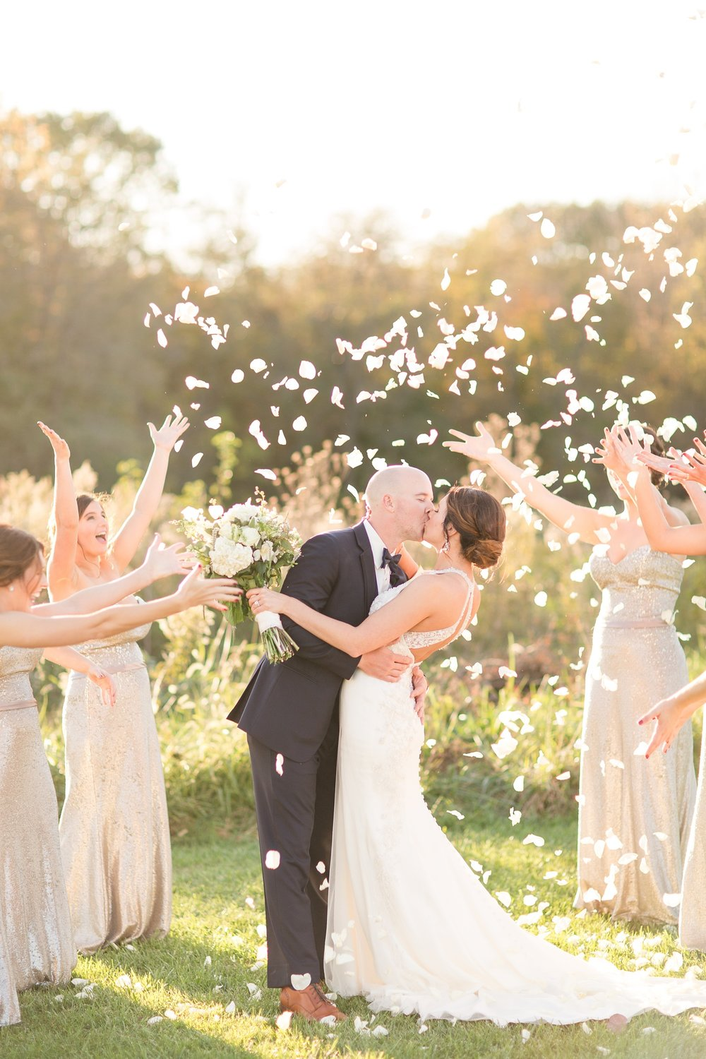Bride and Groom in beautiful light with petals being thrown