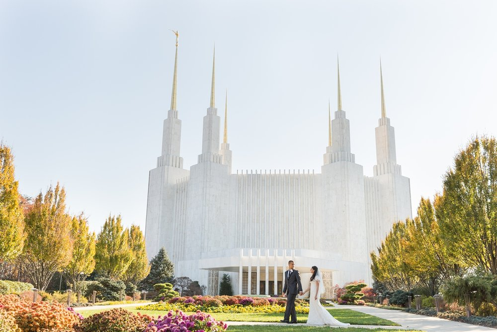 bride and groom walking in front of mormon church