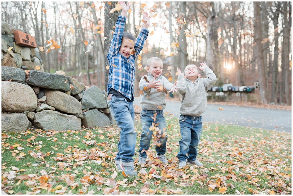 three young boys throwing leaves in the air | How to run a family photo session