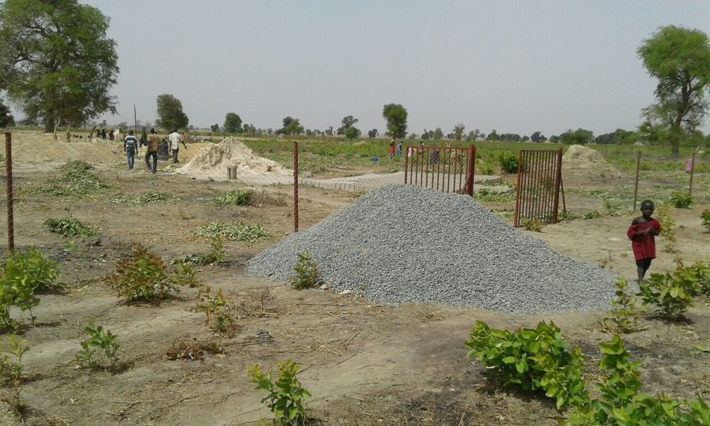 Newly completed fence, along with materials staged for the infrastructure components.