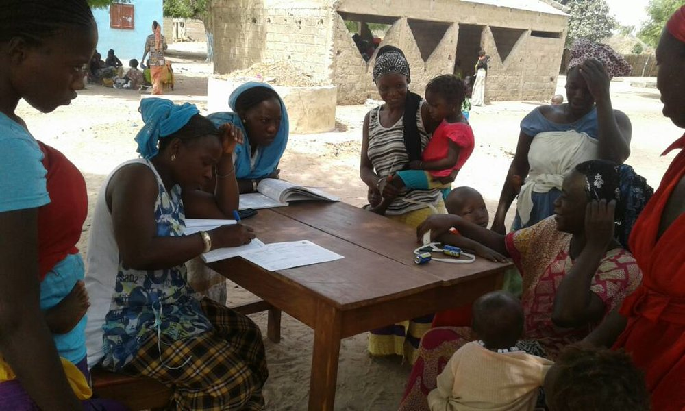 Health workers in Thiamene Taba, Senegal documenting growth in children in the village.