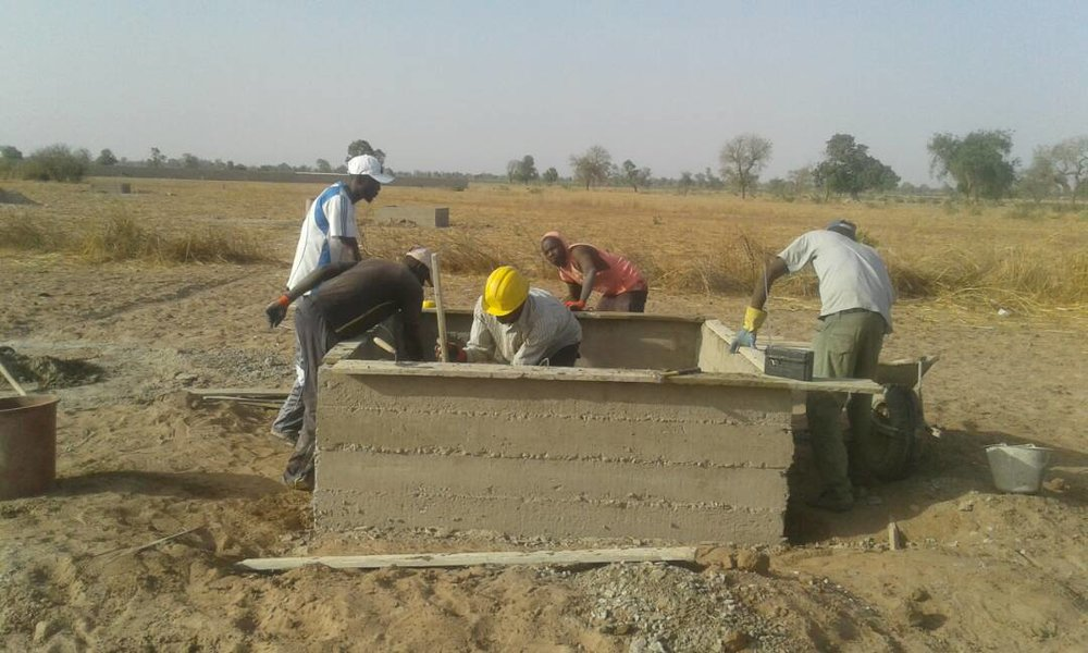 Crews working on the water basins at the site of the Keur Pathe Malick Market Garden
